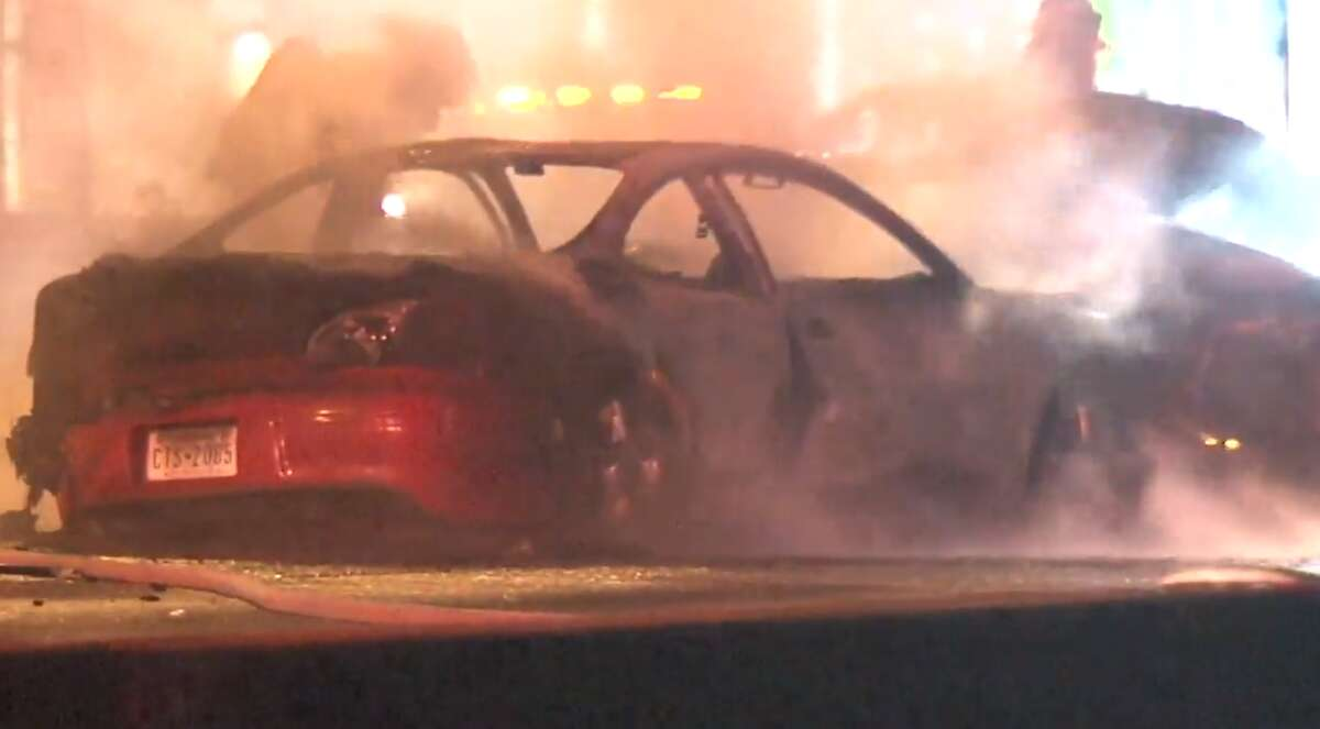 Houston firefighters on Thursday morning work to clear the scene of a fiery crash involving three vehicles on Interstate 45 at Tidwell.