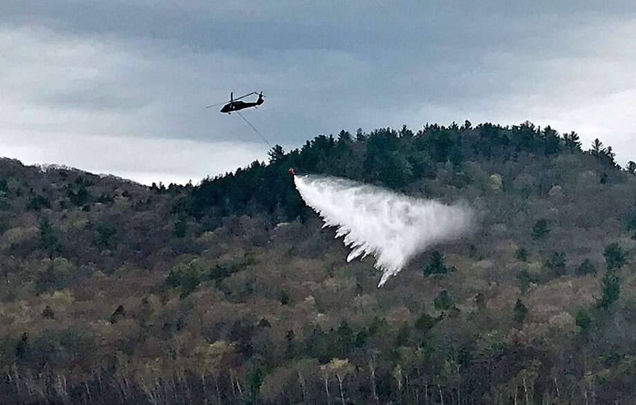 The Connecticut National Guard few UH-60 Black Hawks at the West Branch River Reservoir in Colebrook on Wednesday, May 1, 2019 to conduct aerial water bucket training. If needed, the helicopters would be used in aerial firefighters to battle major forest fires in Connecticut. Photo: Connecticut National Guard Photo