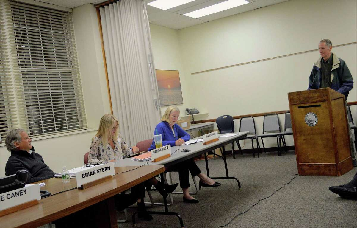 Chairman Brian Stern, at left, talks with Mark Mathias, Board of Education chairman, at the Board of Finance meeting on Wednesday, May 1, 2019, in Westport, Conn.