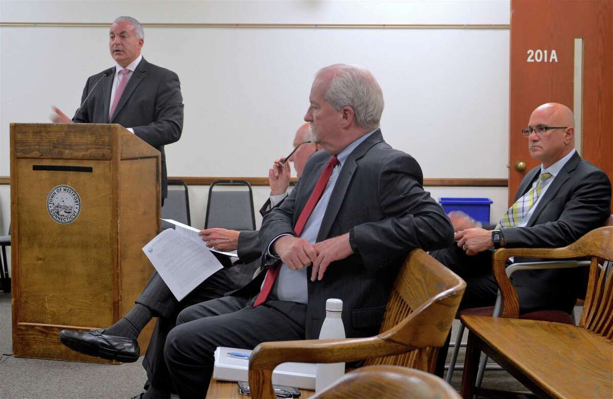 Town Finance Director Gary Conrad, center, and Anthony Buono, acting superintendent, at right, listen to Elio Longo, CFO for Westport Public Schools, answer questions at the Board of Finance meeting on Wednesday, May 1, 2019, in Westport, Conn.