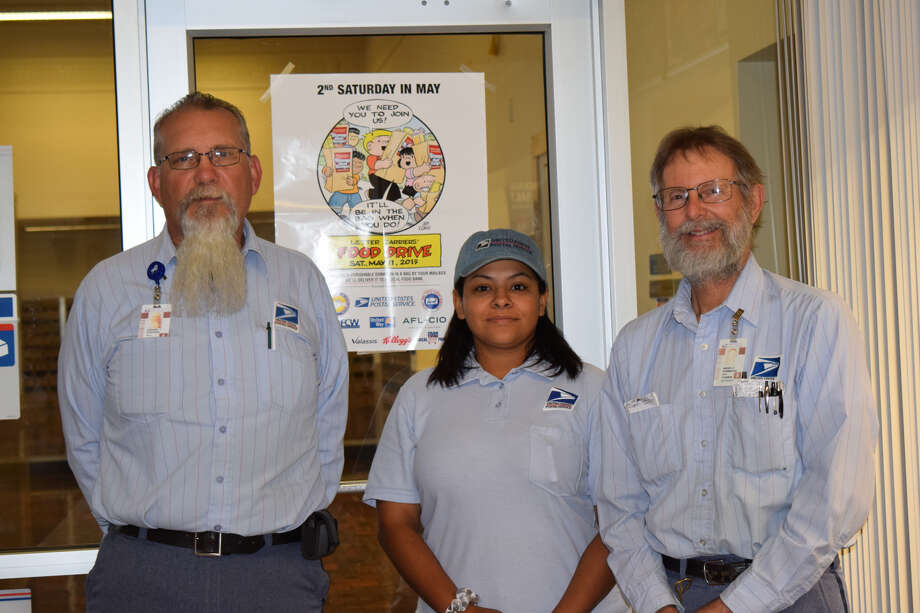 Local postal workers preparing for annual food drive. Pictured (L-R) Howard Steffens, Jennifer Gonzales and Roger Stambaugh Photo: Ellysa Harris/Plainview Herald