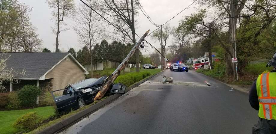 An accident involving a car and utility pole shut down Payne Road the morning of May 2, 2019. Photo: Danbury Fire Department