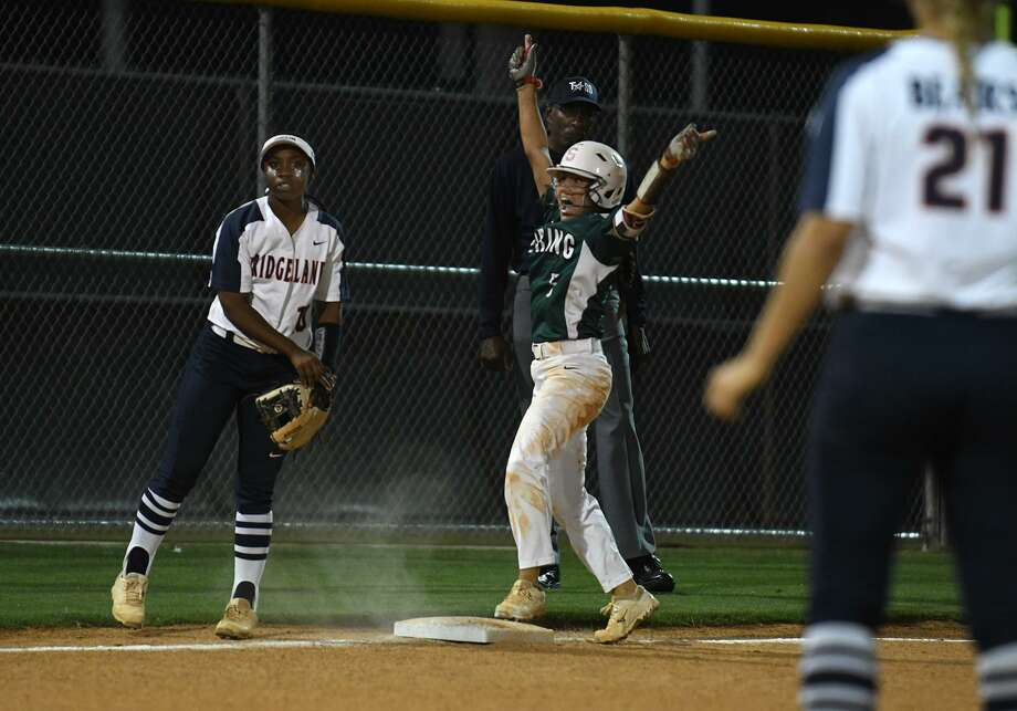 Spring senior shortstop junior shortstop Chloe Gomez, center, celebrates her bases-clearing triple in the top of the 4th inning against Bridgeland and Bears sophomore third baseman Jaelyn Simmons, left, during their Region II-6A Softball Area Playoff Game at Klein Cain High School on May 1, 2019. Photo: Jerry Baker, Houston Chronicle / Contributor / Houston Chronicle