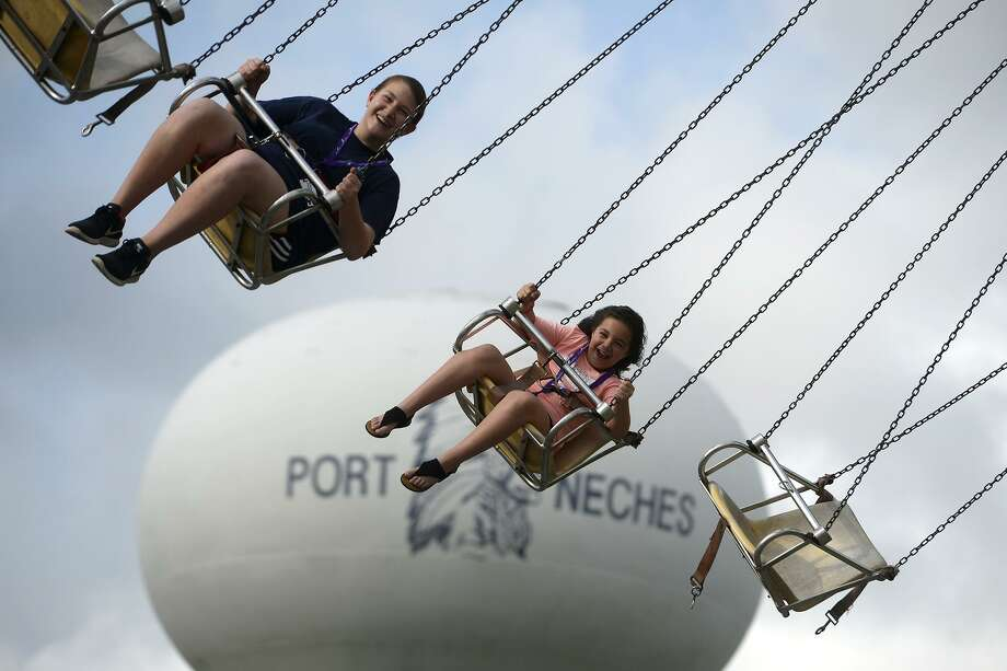Kaylee and Bella Byrd ride the swings at the opening night of the Port Neches Riverfest. The festival continues through Sunday.  Photo taken Wednesday 5/2/18 Ryan Pelham/The Enterprise Photo: Ryan Pelham / Ryan Pelham/The Enterprise / ©2018 The Beaumont Enterprise/Ryan Pelham