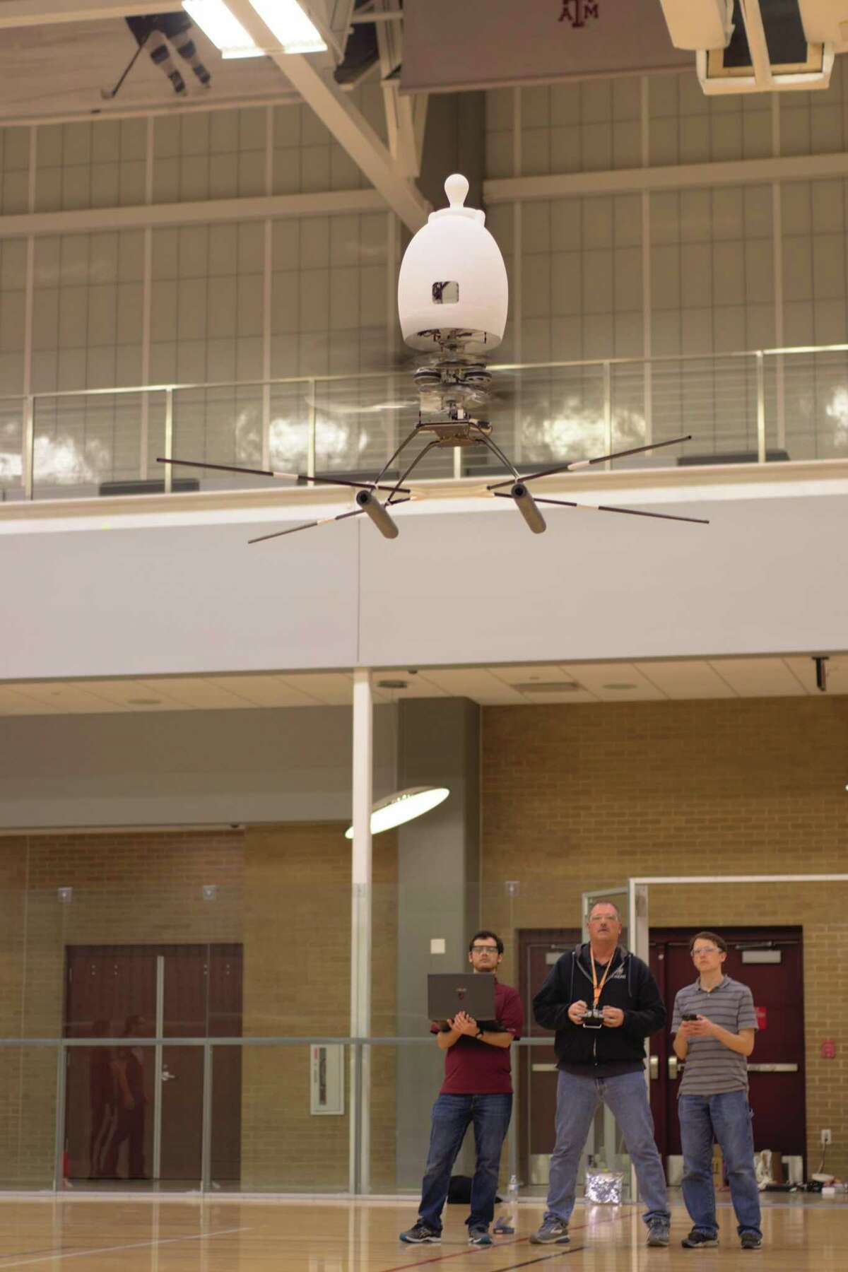 The Texas A&M Harmony team tests a 1/3 scale model of their Aria personal flying device. Pictured, left to right, are Hunter Denton, Scott McHarg and David Coleman.