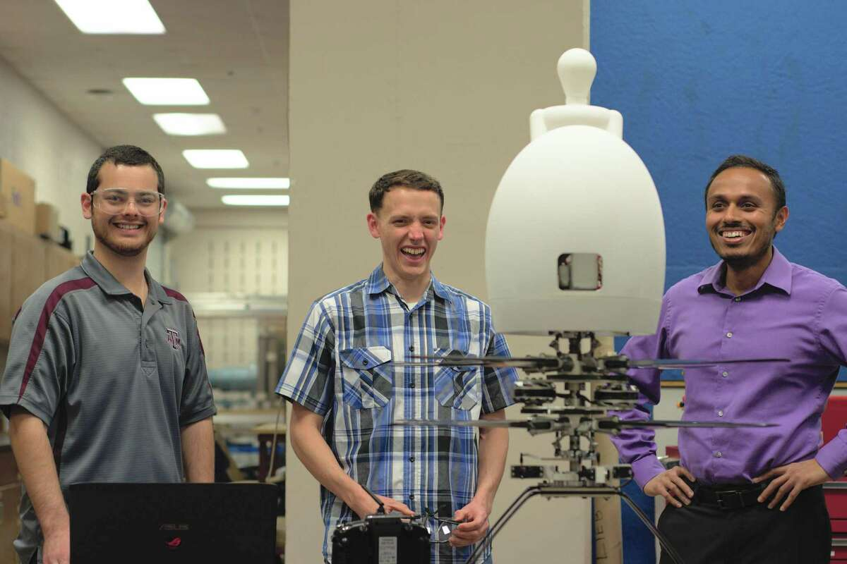 The Texas A&M Harmony team tests a 1/3 scale model of their Aria personal flying device. Pictured, left to right, are Hunter Denton, David Coleman and Moble Benedict.