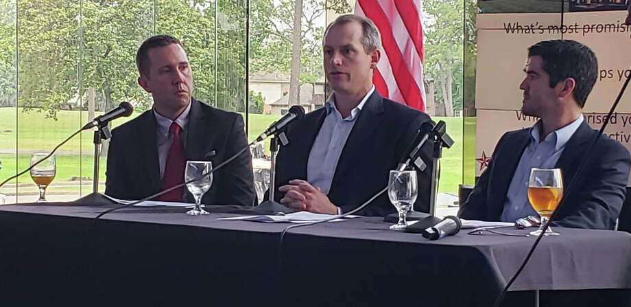 From left to right: Humble City Manager Jason Stuebe, McCord Development Sales and Leasing Director John Flournoy and McAlpine Interests Broker Adam McAlpine speak at the State of the Lake Houston luncheon on April 30, 2019. Photo: Kaila Contreras