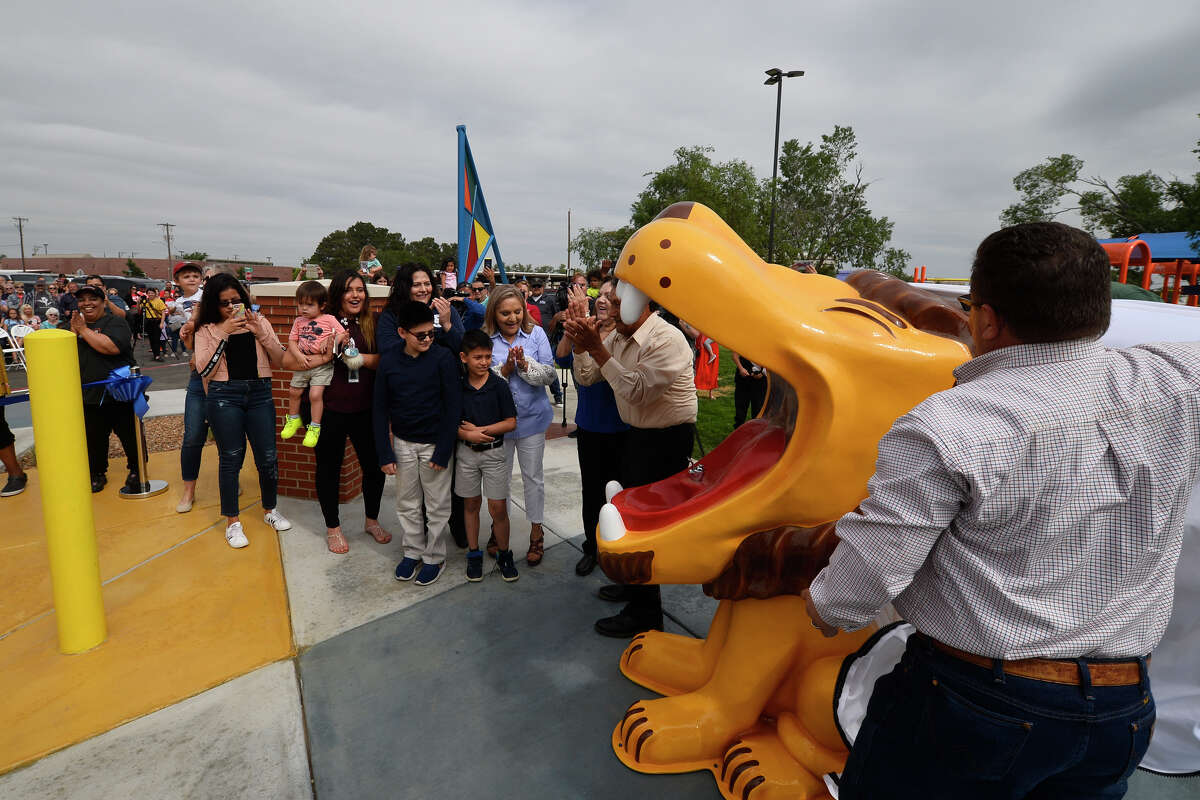 The family of Manuel Rodelo unveil the restored lion drinking fountain statue during the opening celebration of the renovated Dennis the Menace park, May 2, 2019. Rodelo purchased the statue in a state of disrepair more than 20 years ago and donated it back to the city for restoration and use in the park. James Durbin/Reporter-Telegram