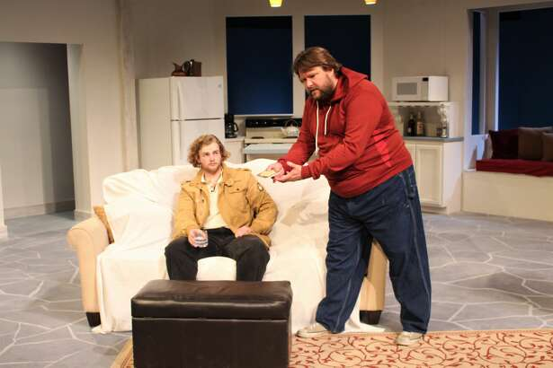 """Matthew Moulton, left, and Nicholas McRae in a scene from """"Beer for Breakfast"""" at Midland Community Theatre."""