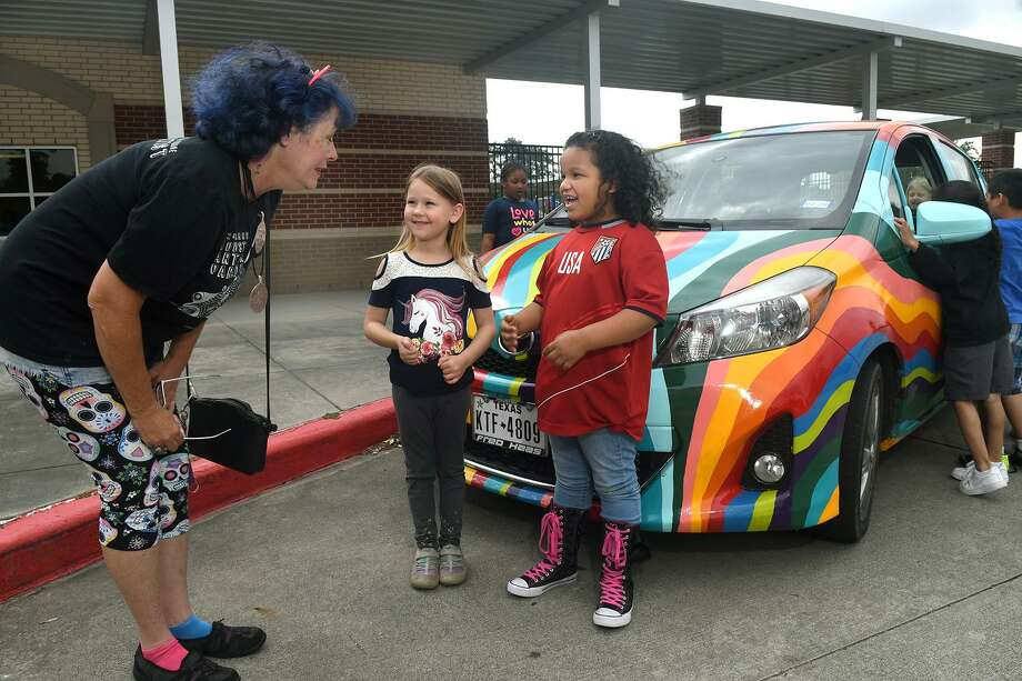 "McNabb Elementary kindergartners Athena Allen, 6, center, and Lorena Ruiz, 6, visit with Kimi Bainter, left, of Montgomery, who was at the school with her art car ""Wrinkles the Hairless Kitty"", along with Paul McRae, of Huffman, who brought along his art car ""Ribbons"", right, as part of the celebration for the Spring ISD Pre-K and Kindergarten Roundup on April 29, 2019. Photo: Jerry Baker, Houston Chronicle / Contributor / Houston Chronicle"