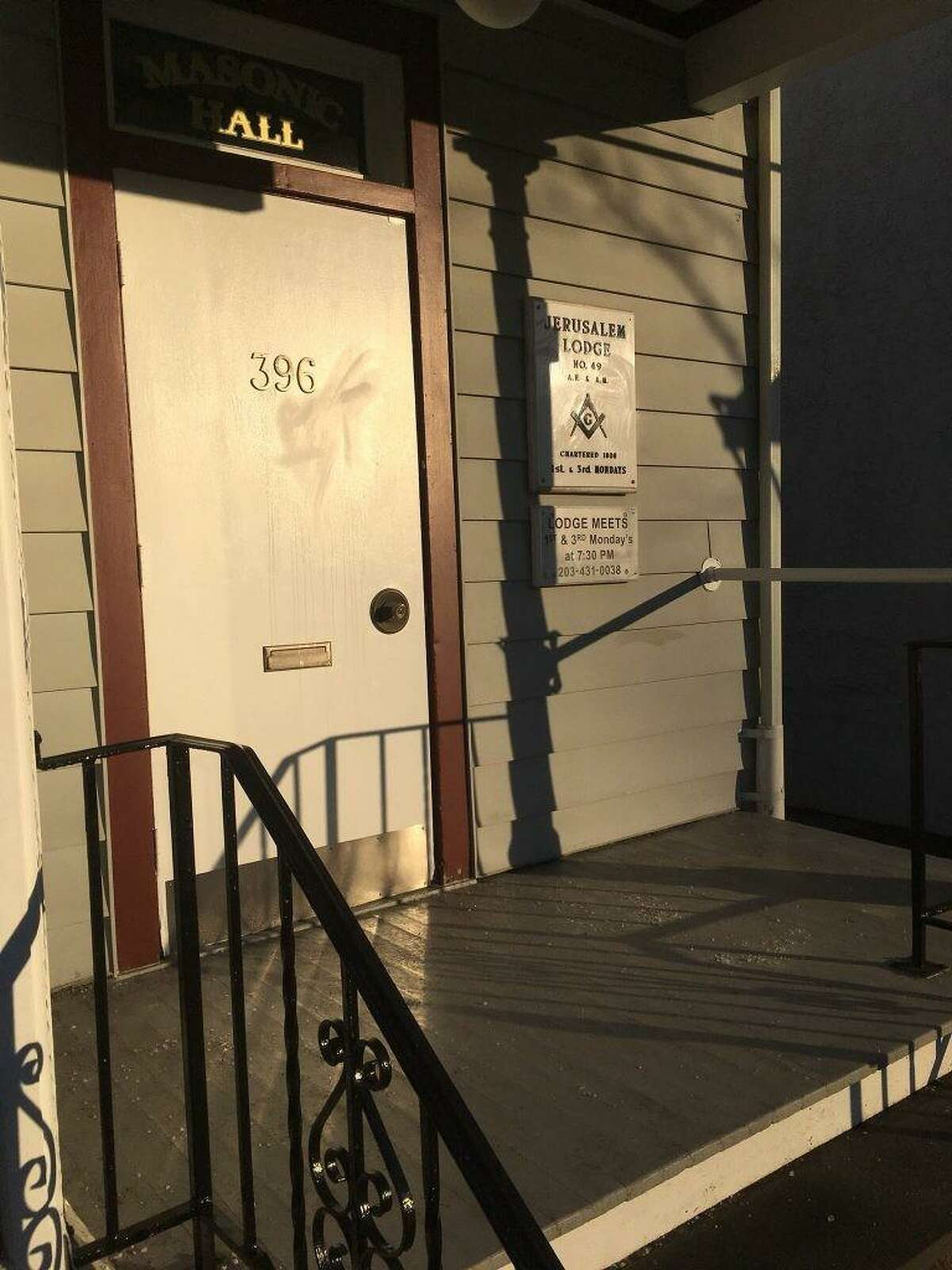 File photo of the front door of the Masonic Lodge on Main Street where a swastika was found Tuesday. The scrub marks from the hate symbol remain on the door.