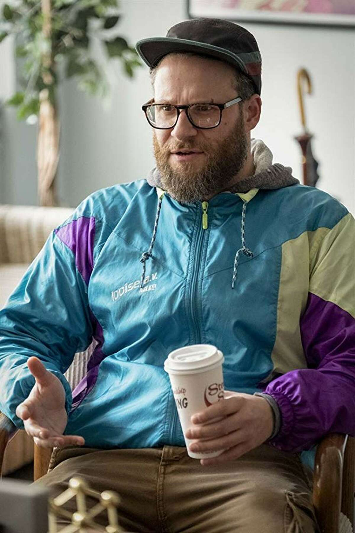 """An image from Lionsgate shows Seth Rogen holding a Stewart's coffee cup in a still from the movie """"Long Shot,"""" opening the first week in May 2019."""