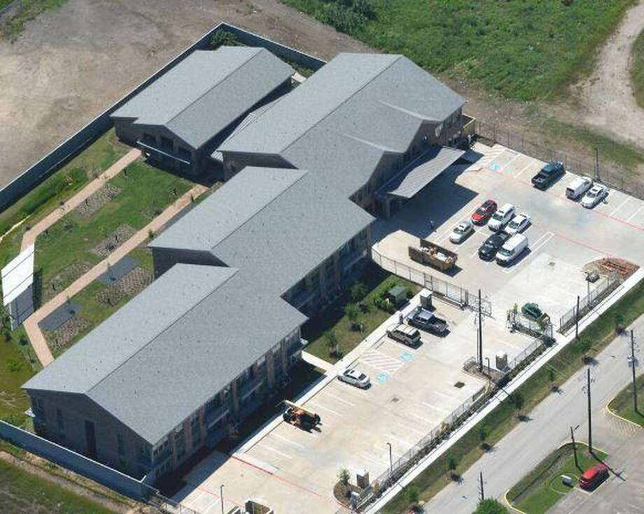 An aerial view of Halo House. The non-profit will hold its grand opening ceremony at 10 a.m. Wednesday, May 15, at its brand new 33-unit apartment facility. Photo: Photo Courtesy Of Aero Photo