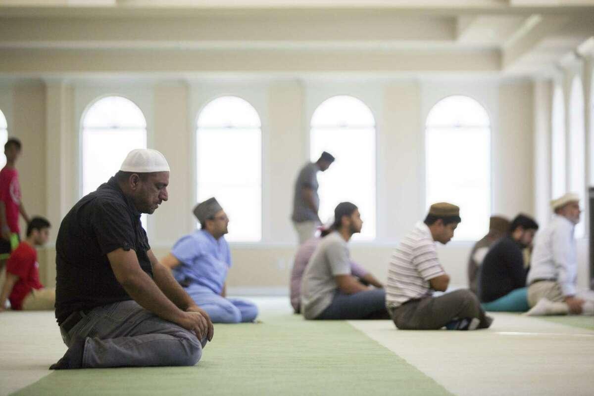 Nasir Ahmad prays during a service led by Imam Rizwan Khan at Islamic Society of Greater Houston, Friday, Aug. 3, 2018, in Houston.
