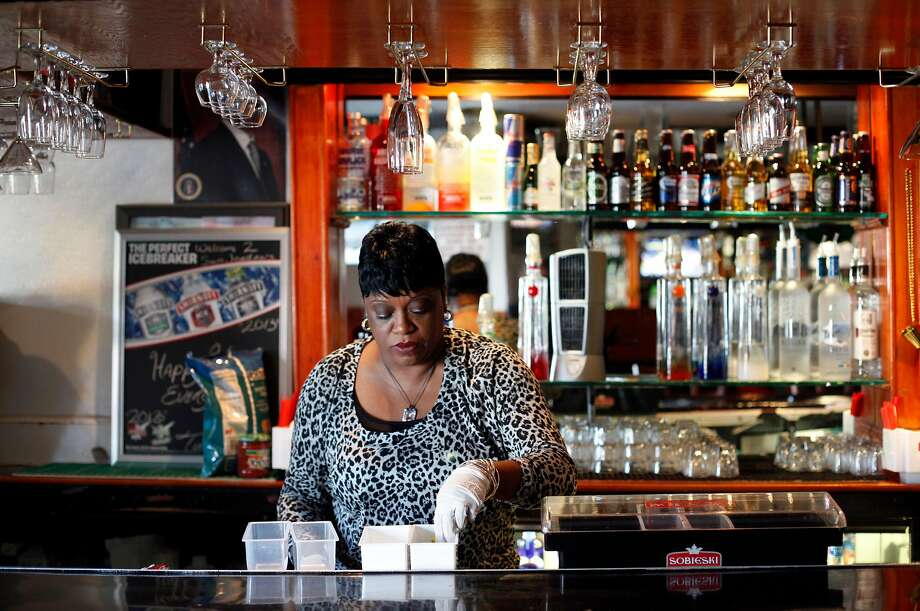 Bartender Denise Tucker gets ready to open at Sam Jordan's Bar in 2013. Photo: Sarah Rice / Special To The Chronicle