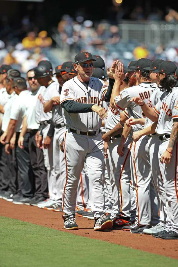 Giants manager Bruce Bochy (15) high-fives members of the team during player introductions prior to a game against the San Diego Padres on Opening Day at Petco Park in San Diego. Photo: Rob Leiter / MLB Photos / 2019 Major League Baseball Photos