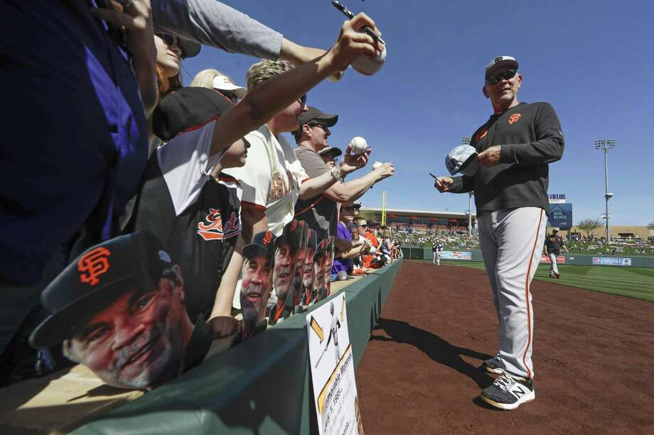 Bochy signs gives autographs before a spring baseball game against the Colorado Rockies in Scottsdale, Ariz. Photo: Chris Carlson / Associated Press / Copyright 2019 The Associated Press. All rights reserved
