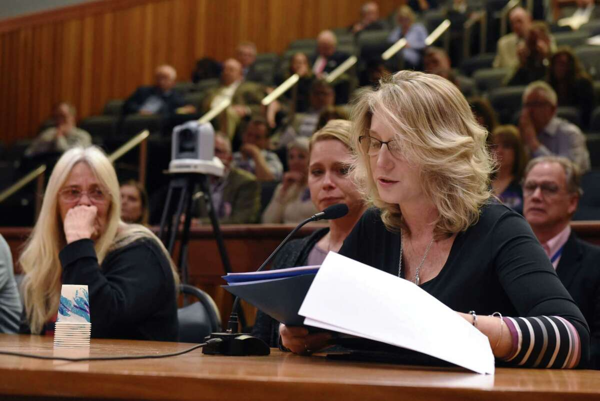Jill Perez reads out Janet Steenburg's testimonial during the State Standing Committee on Transportation hearing on