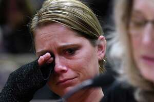 """Kim Steenburg wipes away tears during the State Standing Committee on Transportation hearing on """"Limo and Bus Safety"""" on Thursday, May 2, 2019 at the Legislative Office Building in Albany, NY. Kim Steenburg lost her husband, Rich Steenburg, in the Schoharie Oct. 6 limo crash. (Phoebe Sheehan/Times Union)"""
