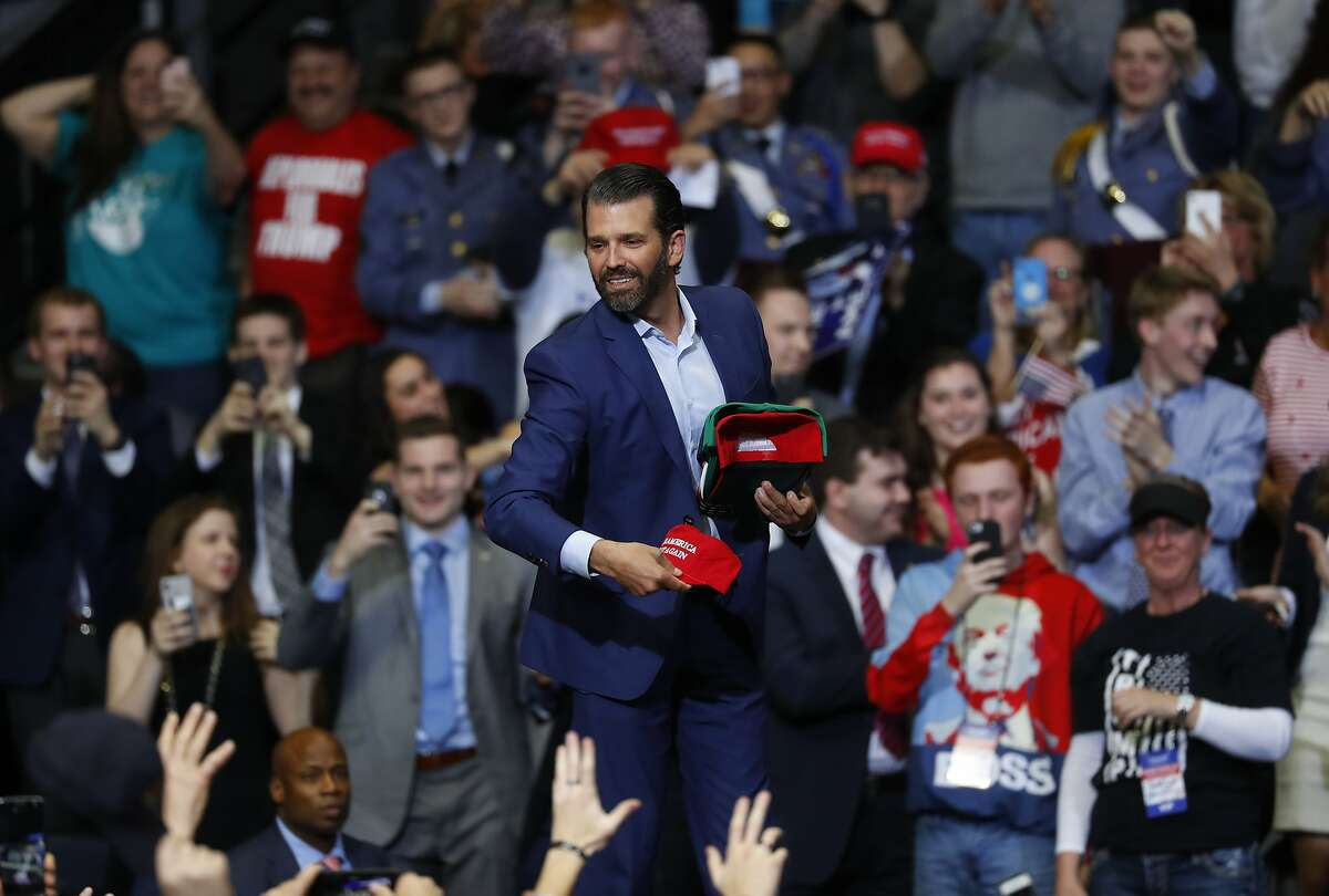 Donald Trump Jr., throws hats to the audience before a rally for President Donald Trump in Grand Rapids, Mich., Thursday, March 28, 2019. (AP Photo/Paul Sancya)