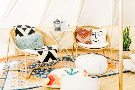 Camp'd Out's luxury furnished tents include area rugs, throw pillows and decor.