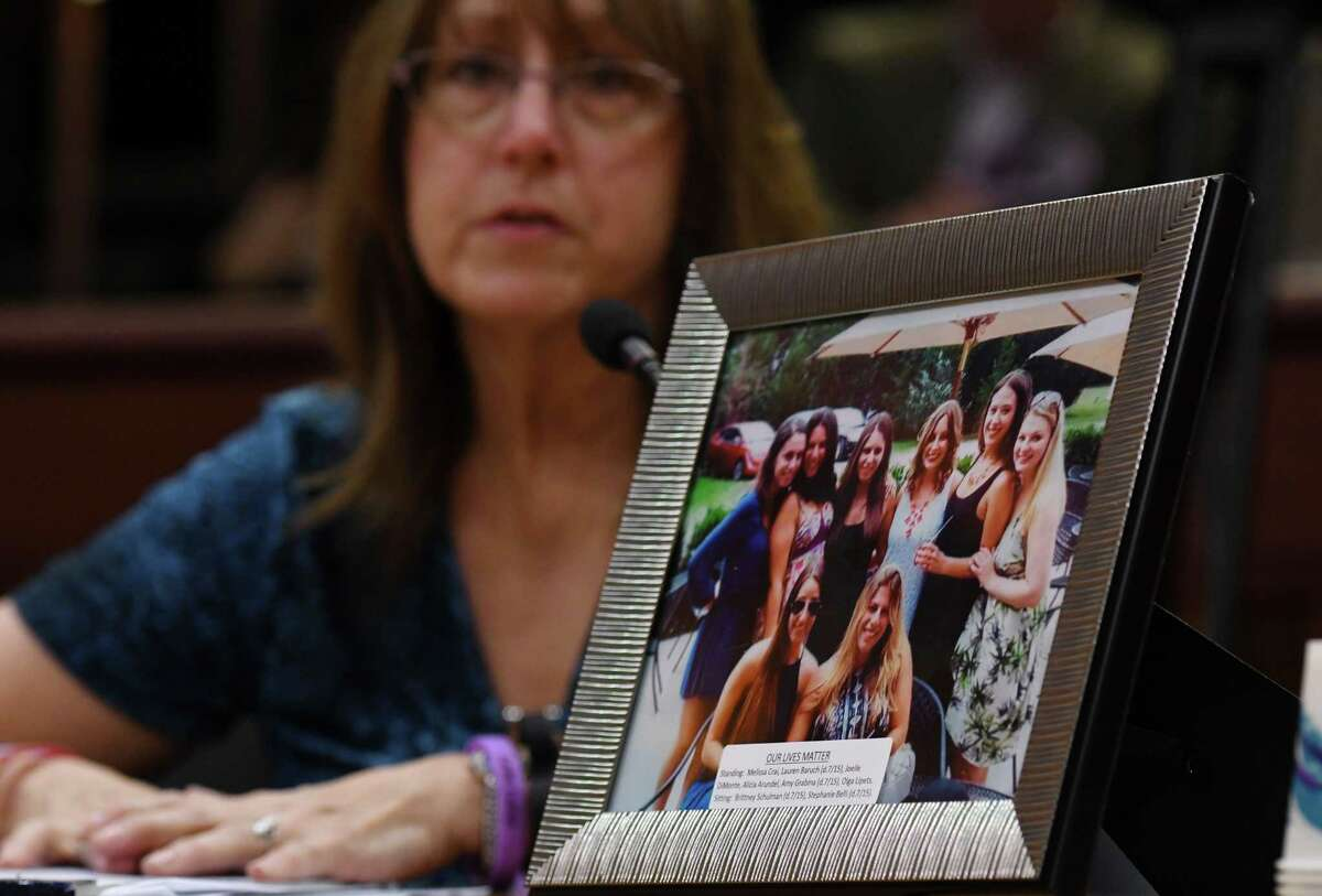 A picture is displayed of the eight women who were in the Cutchogue crash during the State Standing Committee on Transportation hearing on