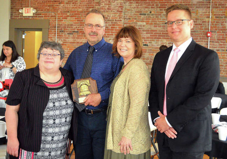 Former Intelligencer reporter Steve Horrell, second from left, received the Liberty Bell Award during Wednesday's Madison County Bar Association Law Day Luncheon at the Wildey Theatre. He was joined by Judge Barb Crowder, left, third vice-president of the Illinois Judges Association; his wife Nancy Horrell, second from right; and MCBA president David Weder. Crowder retired as a Madison County judge at the end of December. Photo: Scott Marion | The Intelligencer