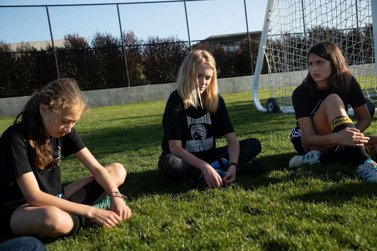 Sydney Lopin, 14, Malea Smith, 12, and Leela Sriram, 14, during an interview after soccer practice about Madlen Koteva, a teammate who was killed by a car near Lake Merced earlier this month. Wednesday, April 24, 2019, in San Francisco, Calif.