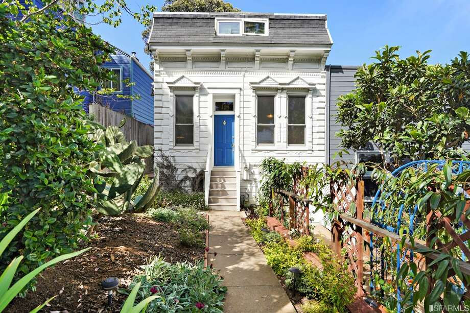A 1900 Victorian at 18 Joy St. is only accessible by a staircase. The charmer has three bedrooms and 1.5 bathrooms. Photo: Aerial Canvas