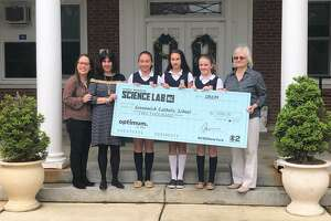 """Three Greenwich Catholic School students won the """"Science Lab"""" program on the """"CBS New Sunday Morning."""" Abby Baram, a representative of Altice USA, which sponsors the program, poses with school Principal Patrice Kopas, students Carmelia Zuniga, Emily Cook and Catherine May, as well as their upper school science teacher Carol Ann Lutz."""