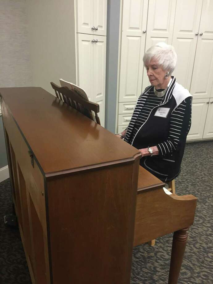 Virginia Derry, resident of Parkway Place, sits at the piano where she plays at least twice a month to play for residents with Alzheimer's disease or dementia. Photo: Photo Courtesy Of Parkway Place