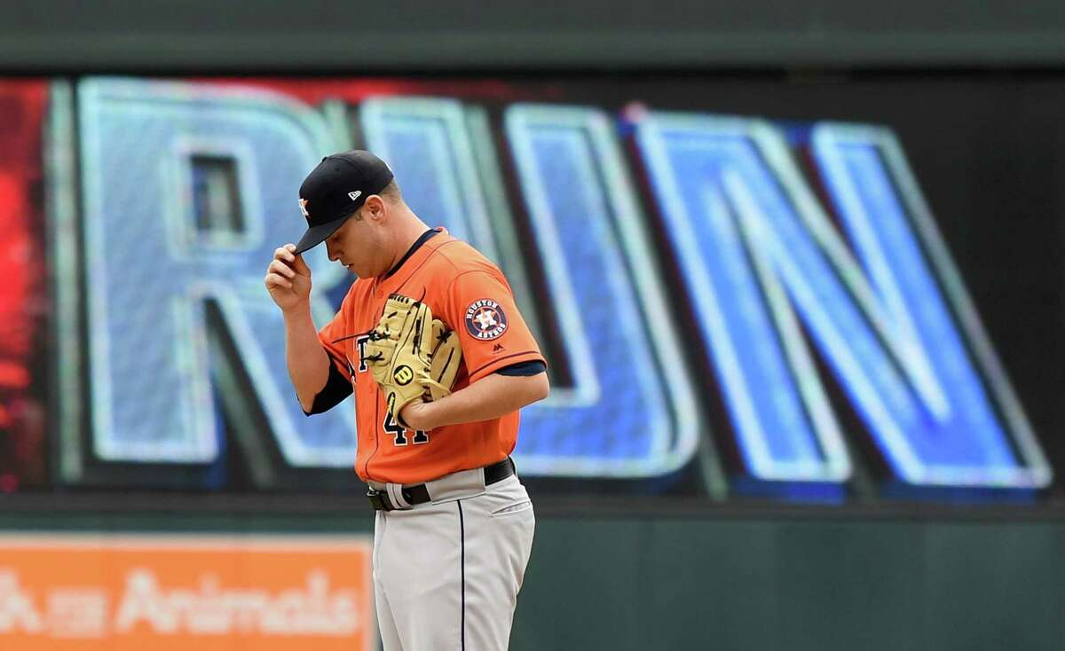 MINNEAPOLIS, MN - MAY 02: Brad Peacock #41 of the Houston Astros reacts after giving up a solo home run to Jason Castro #15 of the Minnesota Twins during the third inning of the game on May 2, 2019 at Target Field in Minneapolis, Minnesota. The Twins defeated the Astros 8-2.
