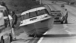 A car crash involving a boat happened on the Northway between exits 13 and 14 on Aug. 8, 1984. (Skip Dickstein/Times Union Archive)