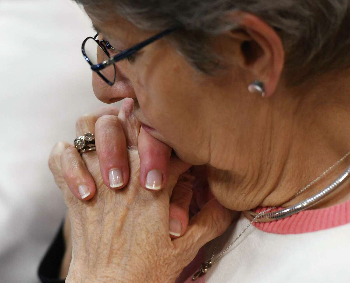 """A woman prays during the National Day of Prayer interfaith program at Town Hall in Greenwich, Conn. Thursday, May 2, 2019. The Town of Greenwich welcomed community religious leaders in a celebration of different religions through scripture readings and prayers for the nation, education, military, government, family, business and media under the theme """"love one another."""""""