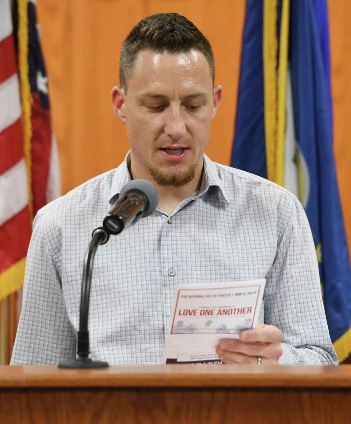 """The Rev. Jake Kircher, of Trinity Church, leads a prayer for America during the National Day of Prayer interfaith program at Town Hall in Greenwich, Conn. Thursday, May 2, 2019. The Town of Greenwich welcomed community religious leaders in a celebration of different religions through scripture readings and prayers for the nation, education, military, government, family, business and media under the theme """"love one another."""""""