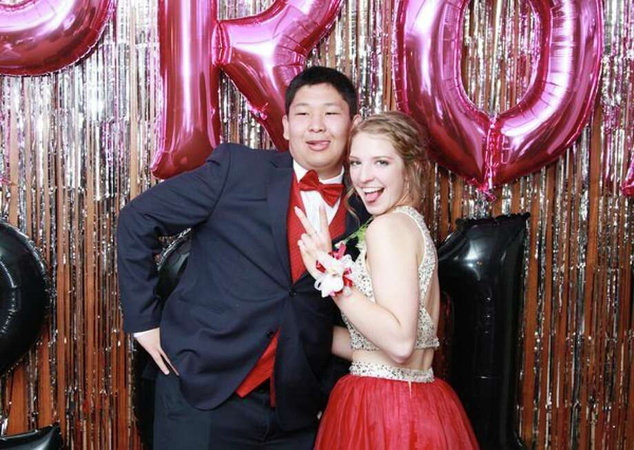 Unionville-Sebwaing Area students Erzhan Umarov and Samantha Barringer strike a pose for the camera Saturday night at USA's prom celebration. For more photos of the night, see Page 8A. (Coulter Mitchell/For the Tribune)