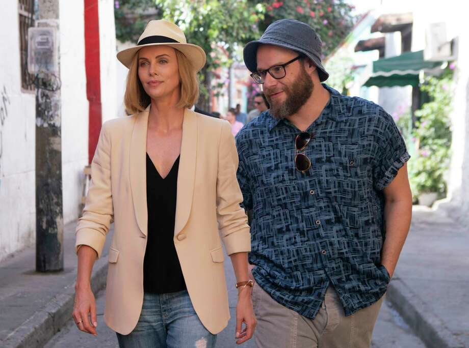 """This image released by Lionsgate shows Charlize Theron, left, and Seth Rogen in a scene from """"Long Shot."""" (Hector Alvarez/Lionsgate via AP) Photo: Hector Alvarez / Lionsgate"""