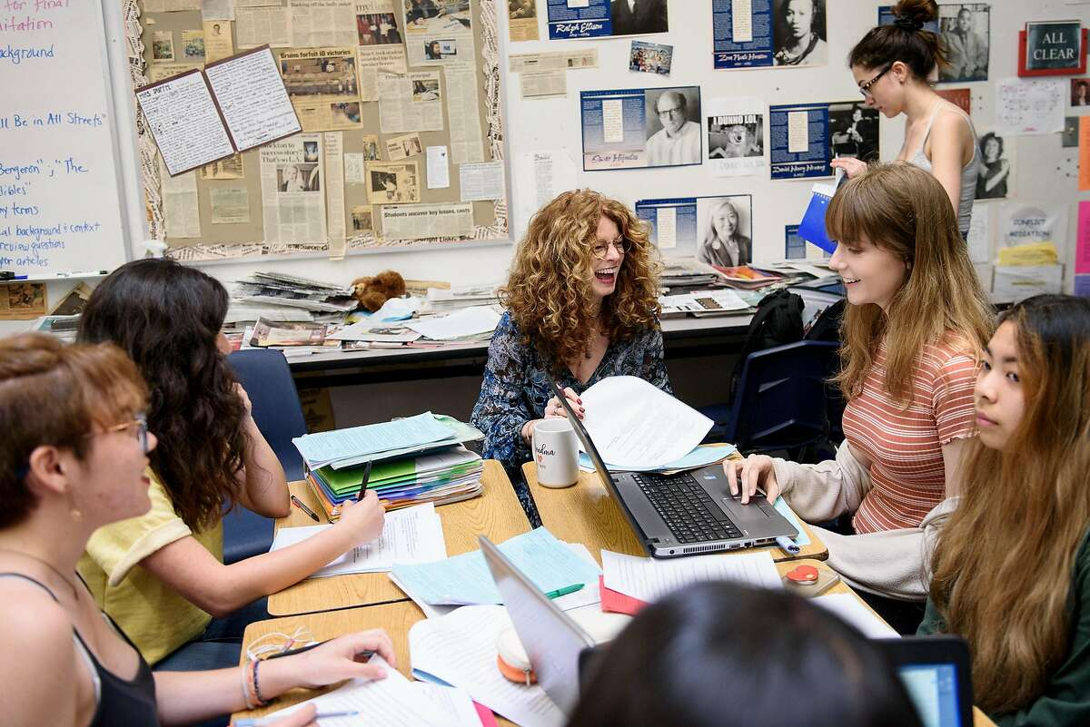 English teacher Kathi Duffel, the faculty adviser for the Bruin Voice student newspaper, works with journalism students as they layout the paper at Bear Creek High School in Stockton, Calif, on Wednesday, April 24, 2019. The Stockton school district is threatening to fire Kathi Duffel, faculty adviser for the Bruin Voice student newspaper, if she doesn't show them a certain story in advance, violating the papers First Amendment freedom of the press rights.