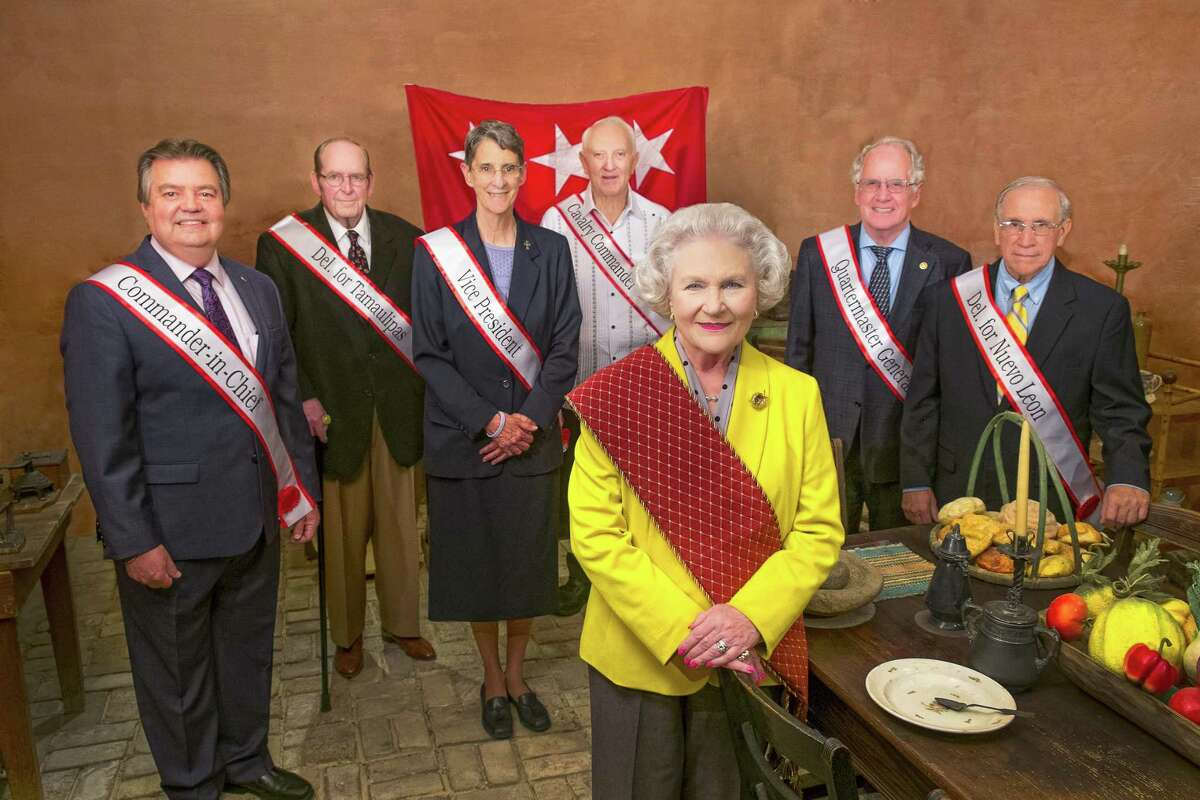 Standing, from left, behind president of the Republic of the Rio Grande Millie Slaughter are cabinet members Robert Sepúlveda, David Slaughter, Sr. Rosemary Welsh, Jim Moore, Bill Green, and Ramón Zertuche Sr. Cabinet member Ricardo J. Solis is not pictured.
