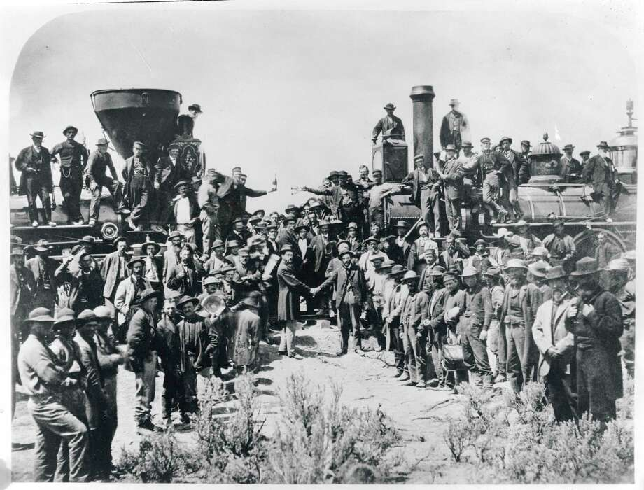 Railroad workers celebrate at the driving of the Golden Spike Ceremony in Utah on May 10, 1869 signifying completion of the first transcontinental railroad route created by joining the Central Pacific and Union Pacific Railroads. Photo: Bettmann, Bettmann Archive / Bettmann