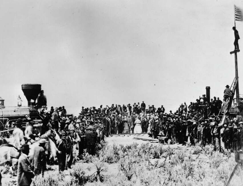 10th May 1869: The golden spike is ceremonially driven in, completing the first transcontinental railroad, at Promontory Point, Utah. On the left is the Central Pacific locomotive, on the right the Union Pacific engine.