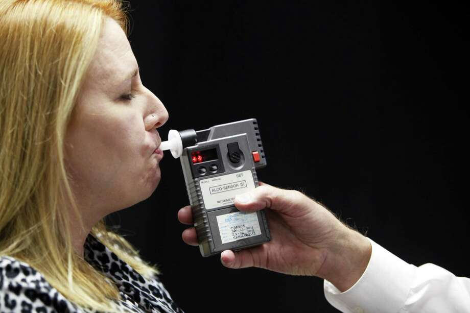 "Christie Wendling, a volunteer participating in the San Francisco Police Department's ""Driving Under the Influence and Standardized Field Sobriety Course,"" uses a breathalyzer. Photo: Cameron Robert / The San Francisco Chronicle File Photo / ONLINE_YES"