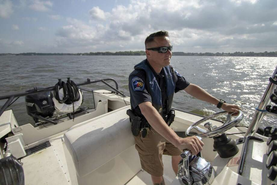 Lt. Tim Cade, with the Montgomery County Precinct One Constable's Office Lake Patrol Division, patrols Lake Conroe Wednesday, May 1, 2019 in Conroe. Photo: Cody Bahn, Houston Chronicle / Staff Photographer / © 2018 Houston Chronicle