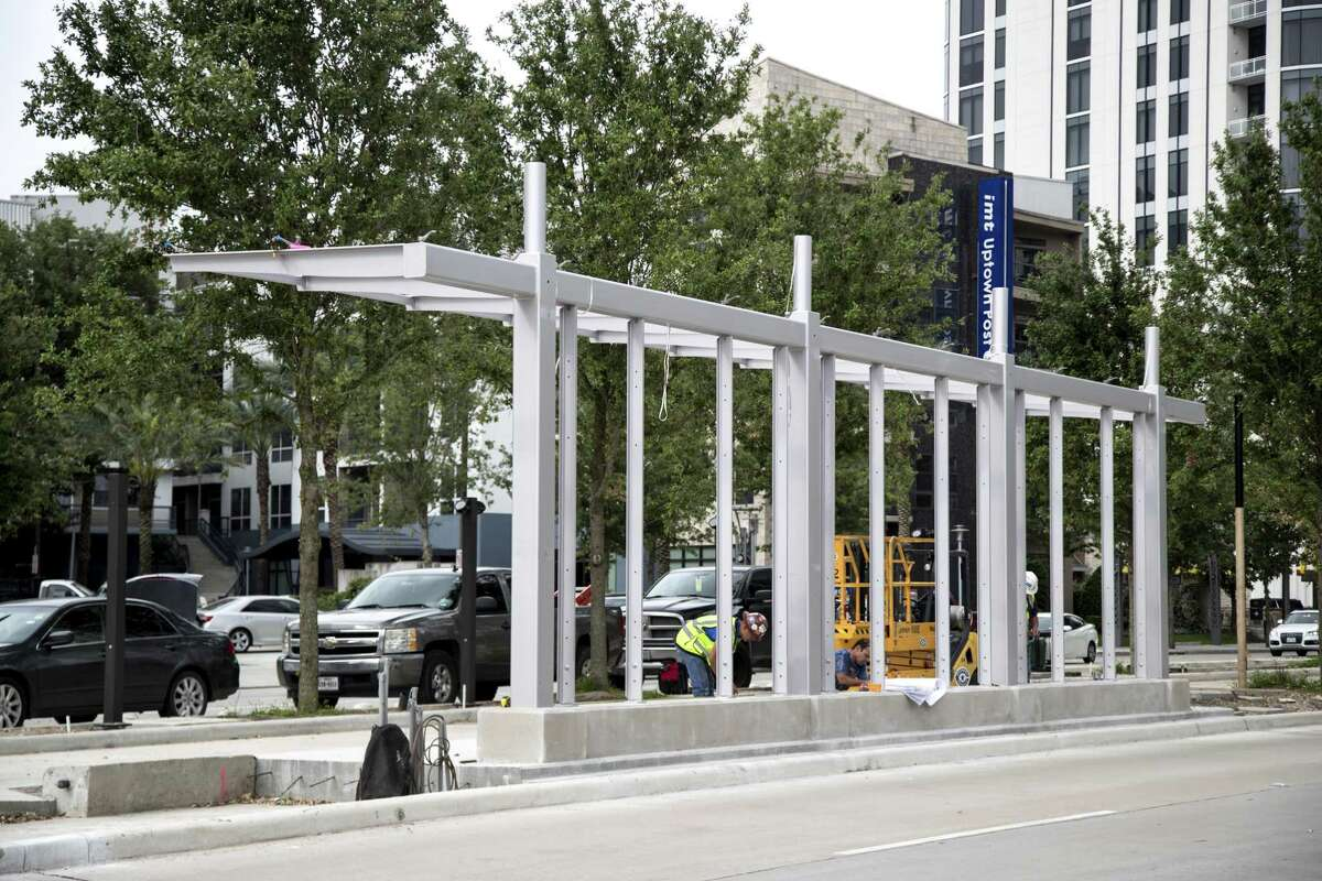 Construction workers build a bus rapid transit station on Post Oak on April 30, 2019, in Uptown. The Post Oak line will be the first bus rapid transit project in the region, though many more are proposed.