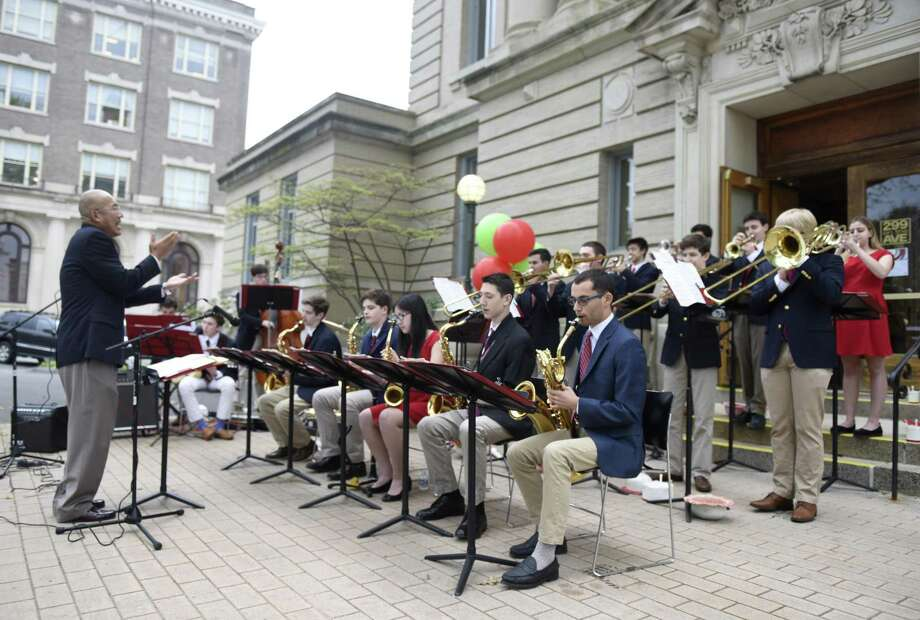 The Greenwich High School Jazz Band performs outside the Greenwich Arts Council and Senior Center during the the Art to the Avenue event along Greenwich Avenue in Greenwich, Conn. Thursday, May 2, 2019. Work from dozens of artists was displayed inside and outside shops as bands performed outdoors before the rain came. Photo: Tyler Sizemore / Hearst Connecticut Media / Greenwich Time