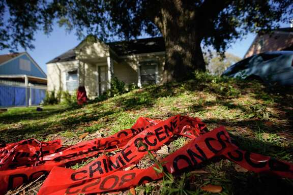 Crime scene tape is shown in the yard of home at 7815 Harding Tuesday, Jan. 29, 2019 where five Houston Police Officers were shot in a gun battle while serving a search warrant on Monday. Police identified the two suspects who died as Rhogena Nicholas, 58, and Dennis Tuttle, 59.