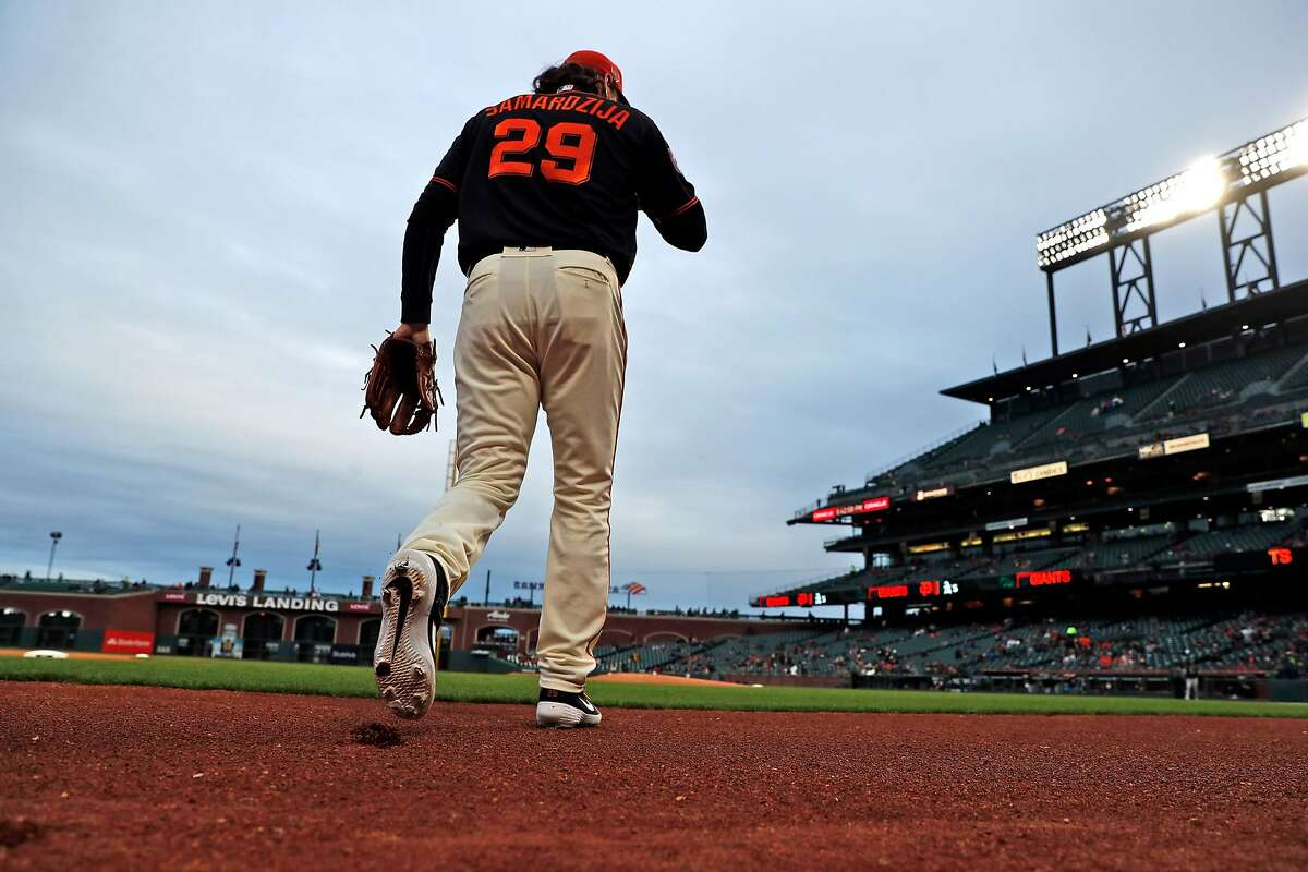 San Francisco Giants' Jeff Samardzija heads to the mound to pitch against Oakland Athletics in Bay Bridge Series at Oracle Park in San Francisco, Calif., on Tuesday, March 26, 2019.