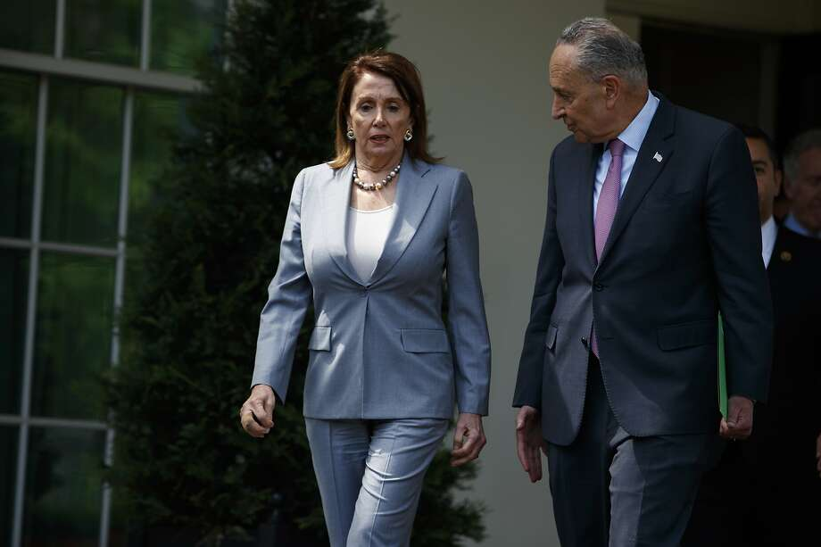 Speaker of the House Nancy Pelosi of Calif., and Senate Minority Leader Sen. Chuck Schumer of N.Y., walk out of the White House after meeting with President Donald Trump about infrastructure, Tuesday, April 30, 2019, in Washington. (AP Photo/Evan Vucci) Photo: Evan Vucci, Associated Press