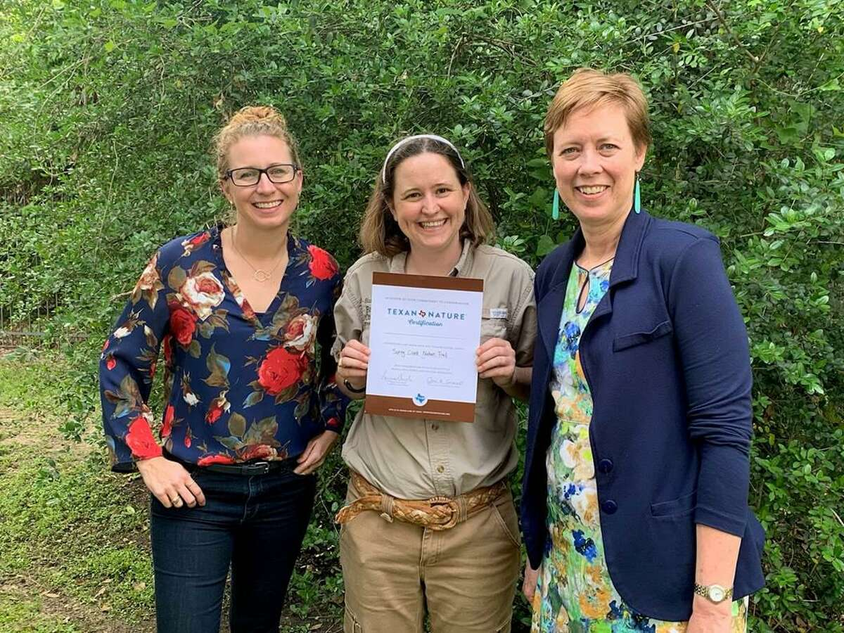 Becky Martinez, Bayou Land Conservancy Conservation Director,Suzanne Simpson, Bayou Land Conservancy Land Stewardship Director andJill Boullion Bayou Land Conservancy Exeuctive Director display the Texan by Nature certificate given for Spring Creek Nature Trail.