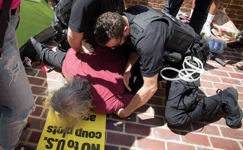 Three protesters were arrested outside the Venezuelan Embassy in Washington on Thursday, May 2, 2019. Around 50 Americans are living in Venezuela's U.S. embassy. Photo: Photo For The Washington Post By Evelyn Hockstein. / Evelyn Hockstein